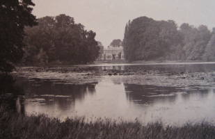 Photograph of house from the lake.