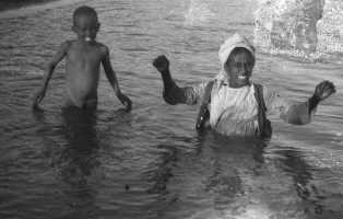 Photograph of two boys playing in the Nile.