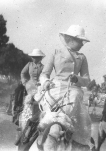 Photograph of ladies riding camels.